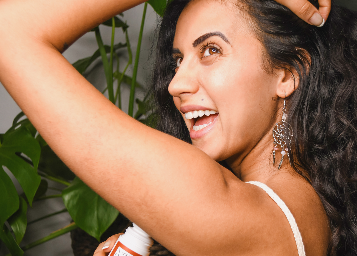 Woman smiling about her natural deodorant by Source Vital Apothecary