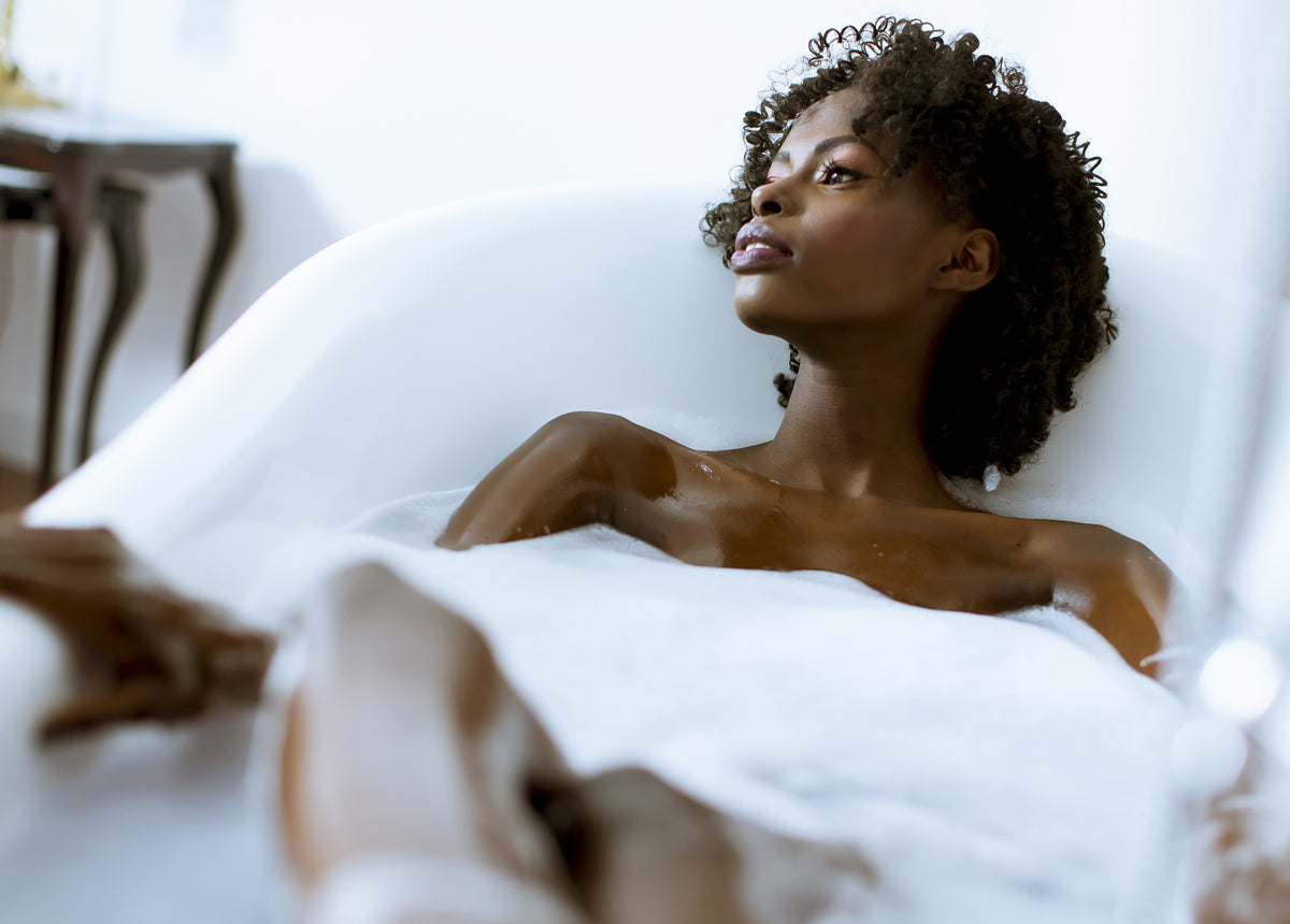 lady relaxing in the bath for self-care