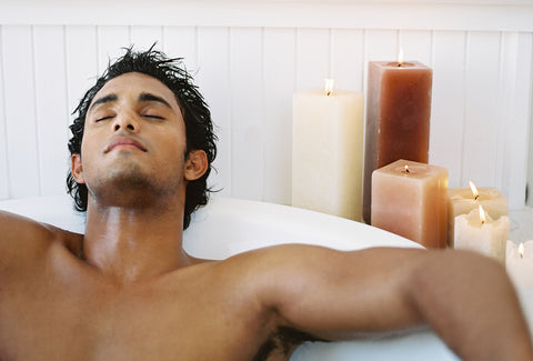 Man taking an aromatherapy bath