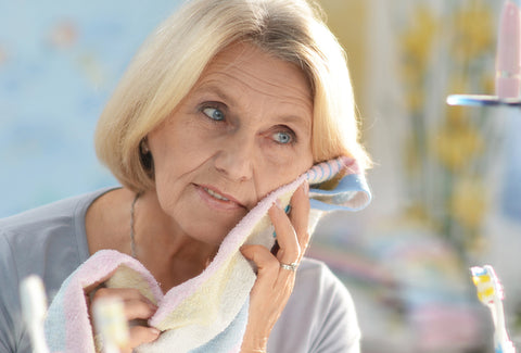 Mature woman caring for skin