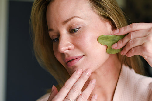 How to give yourself a facial massage with a gua sha stone