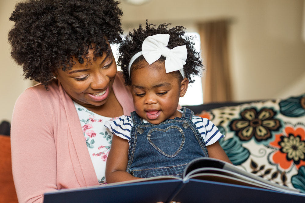 mom reads book to her daughter