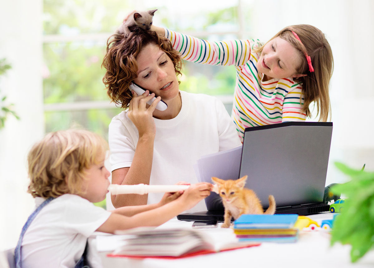 Parent working from home while kids are distance learning