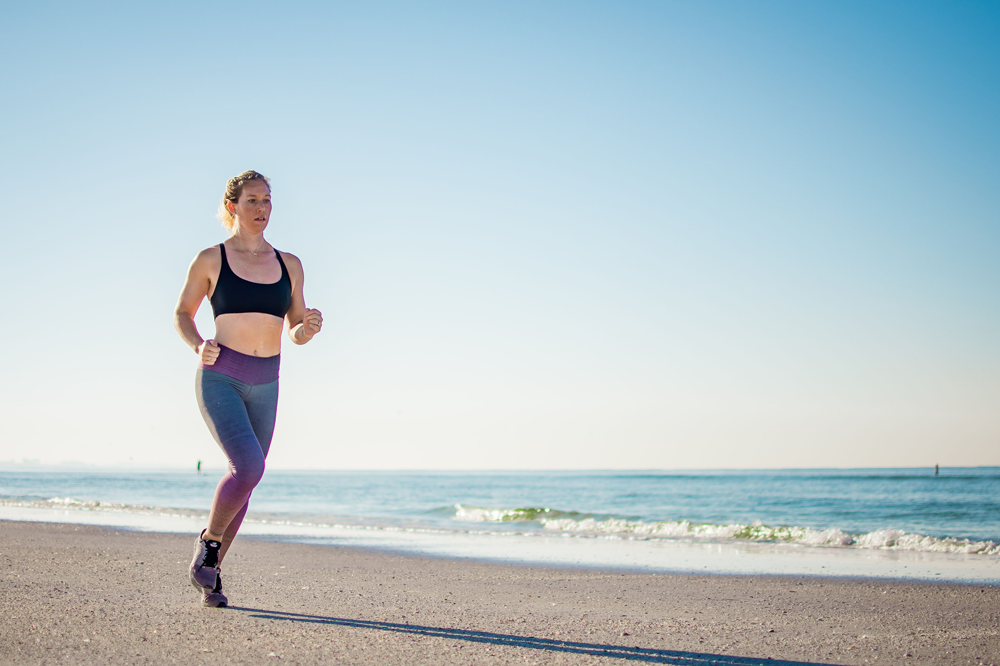 Woman running at the beach for good health