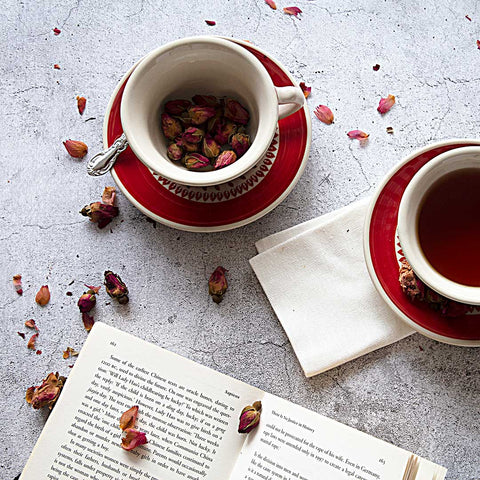 coffee tea cups from gz33 roses collection and a book on a table