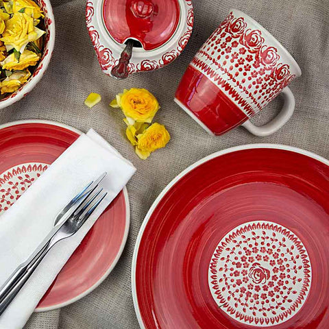 hand-decorated ceramic tableware from roses collection viewed from above