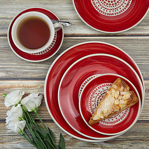 tea and delicious cake served on hand-decorated ceramic tableware from roses collection
