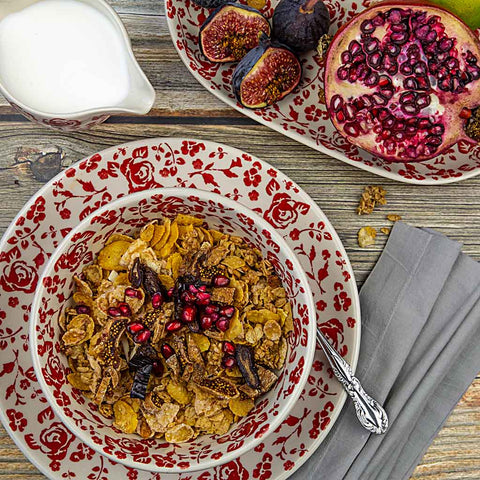 cereal and pomegranate served on ceramic hand-decorated tableware from roses collection