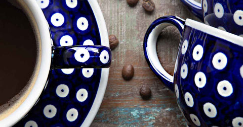close up of hand-decorated coffee tea cup with saucer polka design