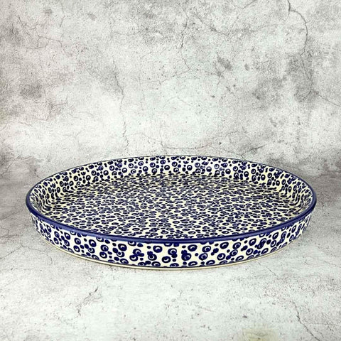 hand-decorated round platter made from Polish pottery and hand-decorated with blue bubbles patter