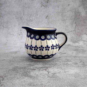 166A HAND-DECORATED POTTERY CREAMER