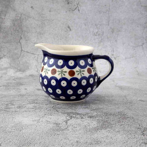 41 HAND-DECORATED POTTERY CREAMER