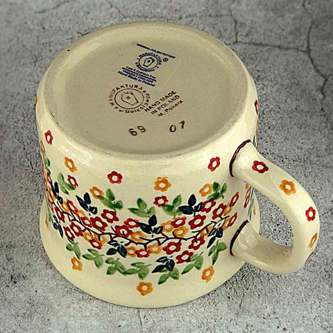 hand-decorated manufactura logo on the bottom of tiny flowers taurus coffee tea mug