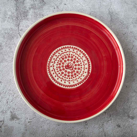 ceramic hand-decorated round platter plate with delicate floral pattern in the center and strong red planes around roses collection gz33