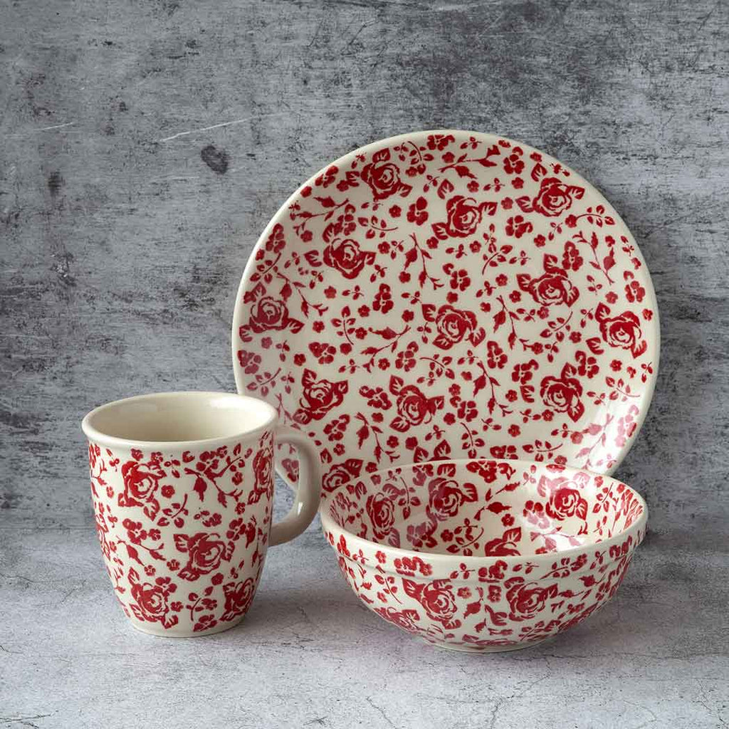 Hand decorated roses collection ceramic breakfast set that comprises a plate, a coffee tea mug and a bowl