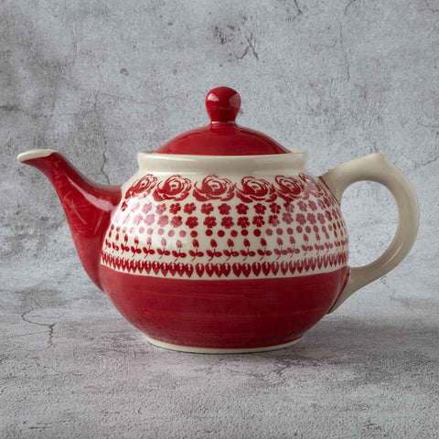 ceramic teapot 0,7l hand-decorated with gz33 pattern that features roses and red planes