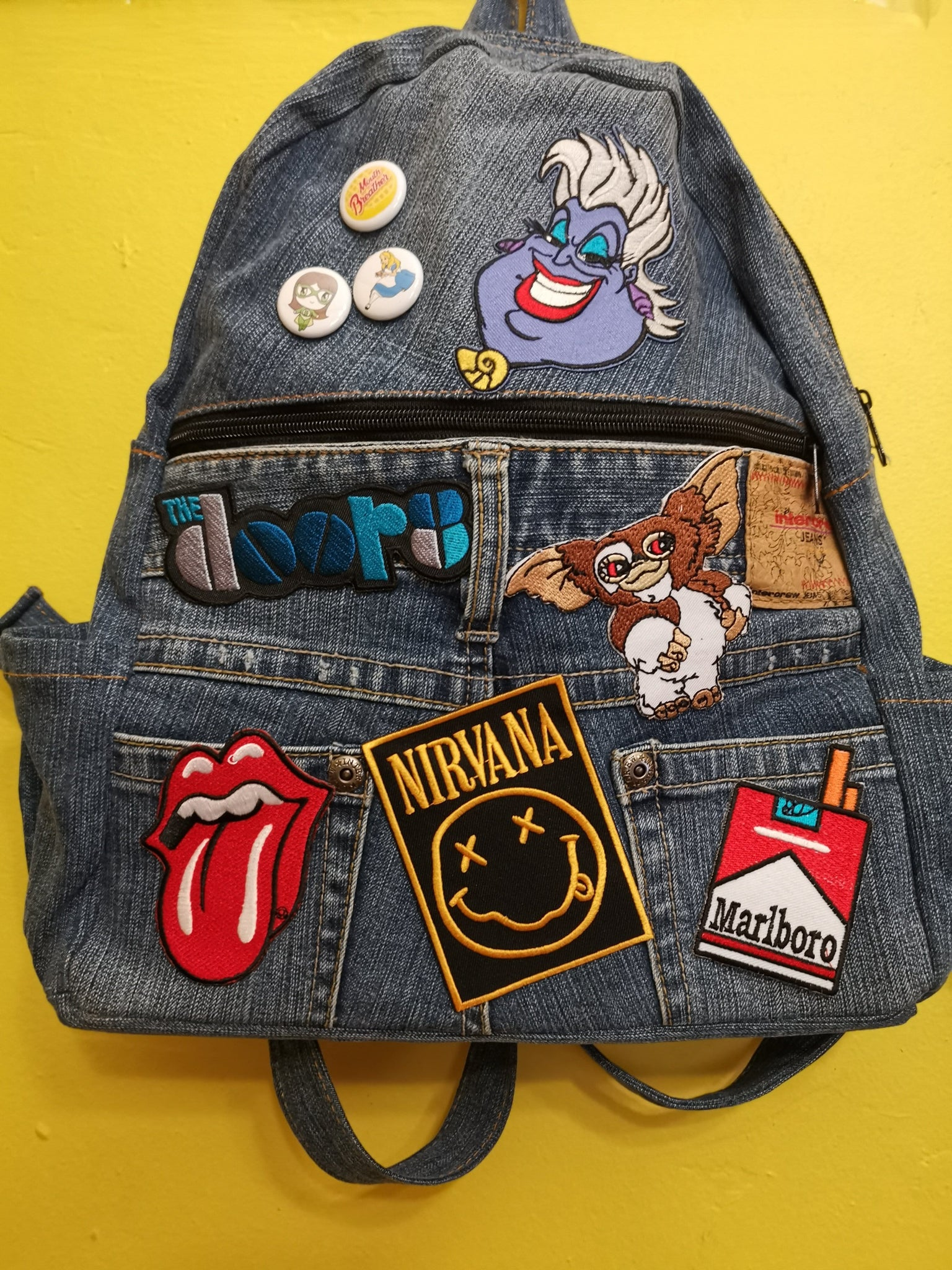 Recycled Denim backpack with patches & pins