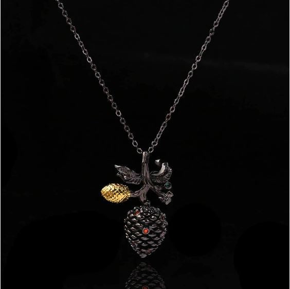 black gold neclace pine cone pinecone red green
