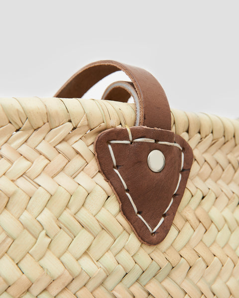Close up of French Market Basket Bag, Hand woven with natural materials and leather straps. | 'JENTL