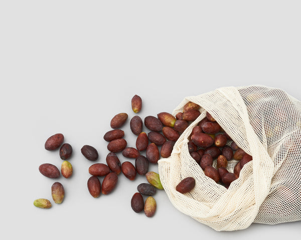 Eco friendly cotton mesh produce bags holding olives | 'JENTL