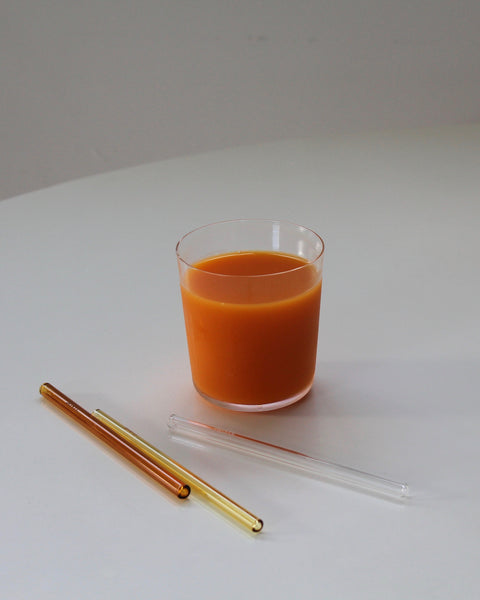 Coloured Glass Drinking Straws, Short cocktail style. Clear, Yellow and Amber with a glass of Orange Juice