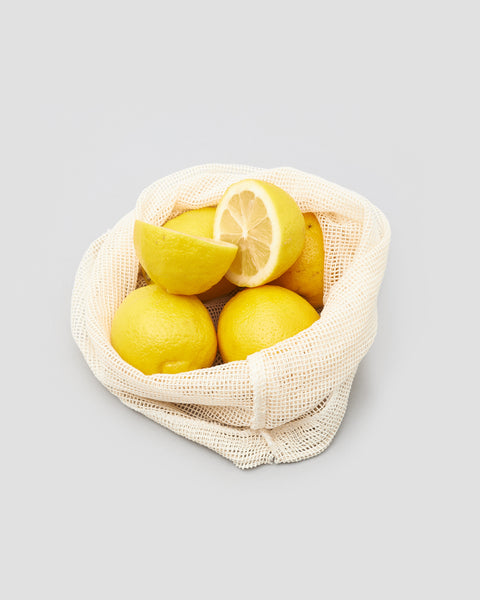 Reusable Cotton Mesh Produce Bag holding Lemons | 'JENTL