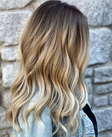 Woman with brown hair with blonde balayage