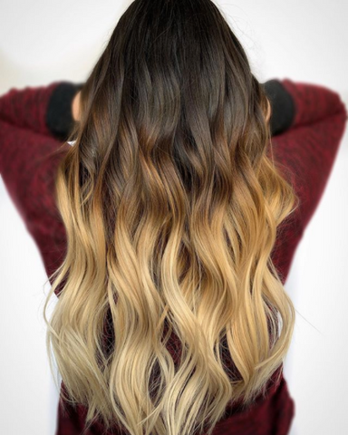 Woman with long, ombre hair that goes from brown to blonde