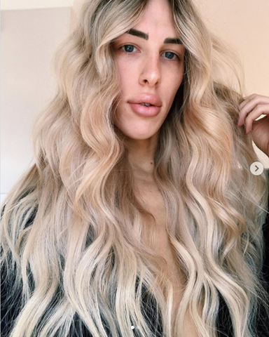 Person with blonde waves
