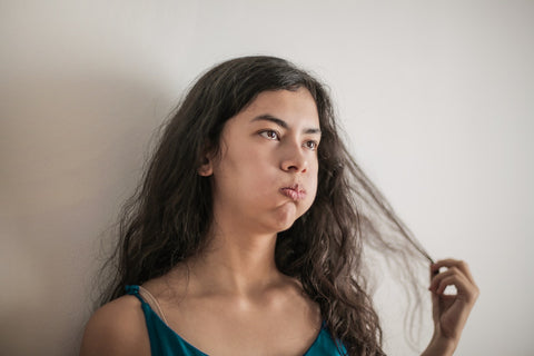 Distressed woman touching her hair