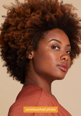 Model with fro on peach background