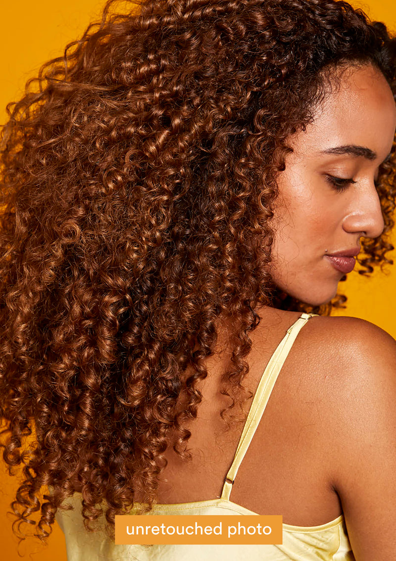 Model with curls on orange background