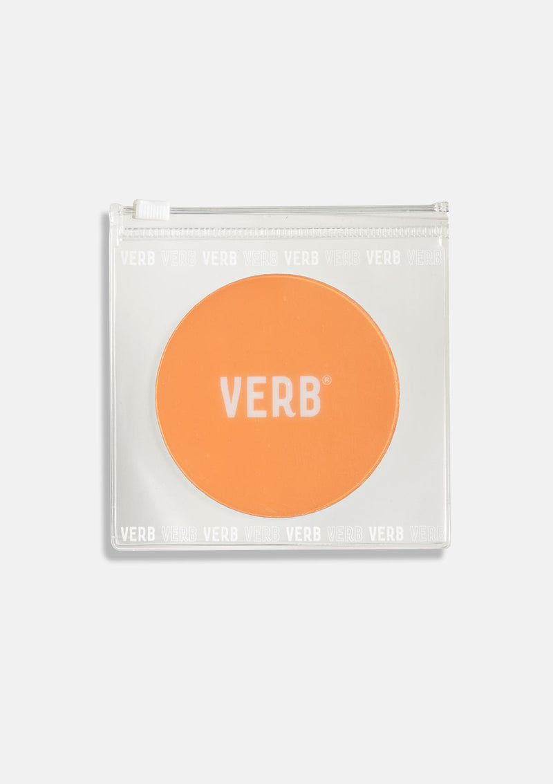 Verb Mirror in pouch, on a grey background
