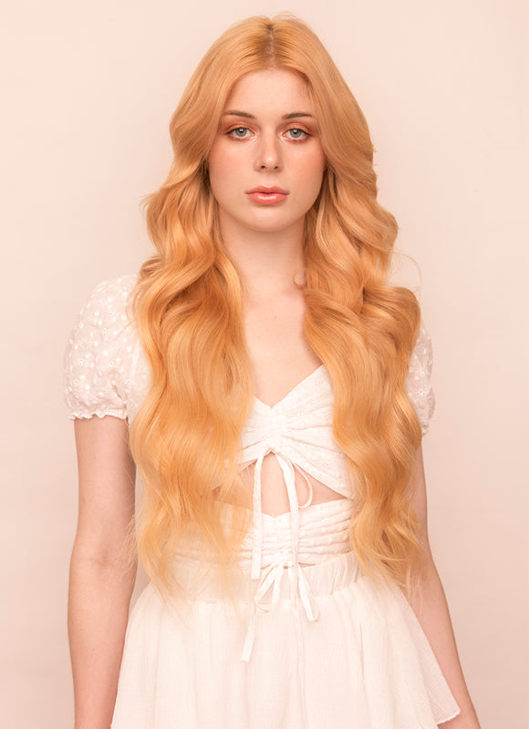24 Inch Deluxe Clip in Hair Extensions #27 Strawberry Blonde