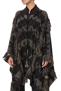 HIGH NECK KNIT JACQUARD PONCHO WITH TASSELS FLIGHT OF AMUN-RA