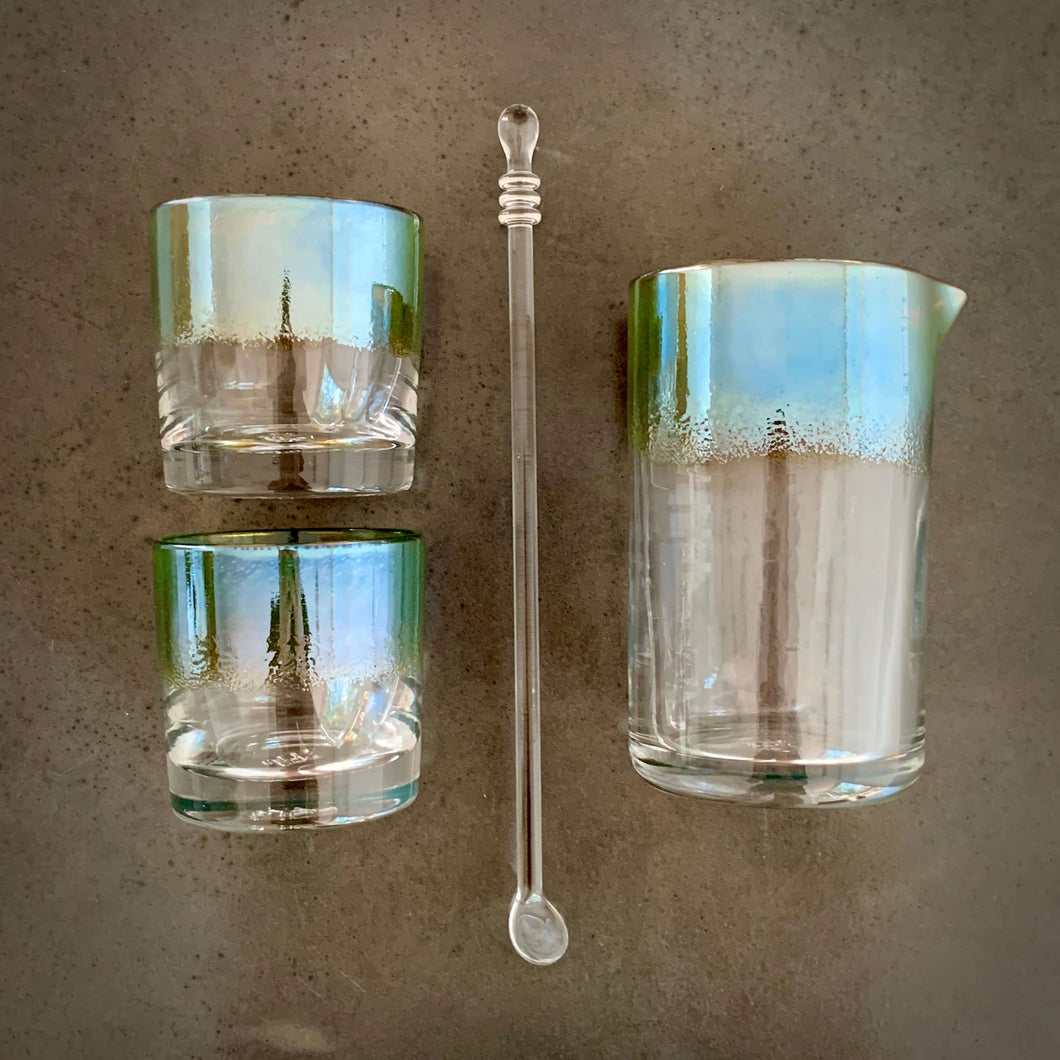 Antique Silver Cocktail Set - Alined in a grid pattern, two rocks glasses, one spoon, and one mixing glass, all with matching metallic silver / teal color band.
