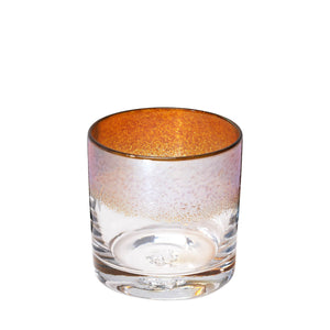 The Aristocrat cocktail glass with transparent amber / orange color stripe and metallic reflection.