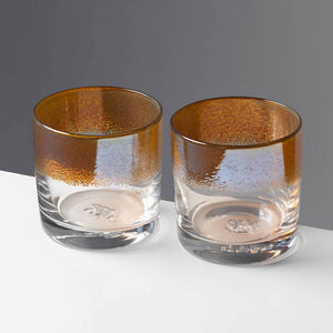 The Aristocrat cocktail glasses with transparent amber / orange color stripe against a contrasting gray background.