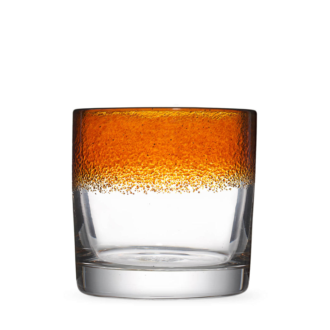 The Aristocrat rocks glass with transparent amber / orange color stripe.