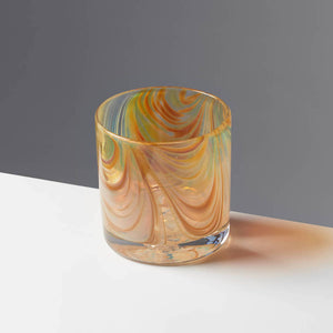 Oak Grain style cocktail glass with amber and tan swirls against a contrasting gray background.