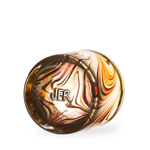 Oak Grain style Rocks Glass with amber and tan swirls, bottom of cup with a stamp of the Artists Initials.