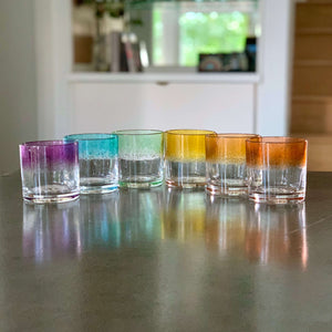 Set of 6 Rocks Glasses in a striped ROYGBV rainbow color pattern.