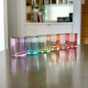 Set of 6 rocks glasses in a ROYGBV rainbow color line up. Each glass is one solid color.