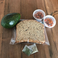 photo of bread, avocado, relish and toppings that make up The Gentry's Avocado Toast