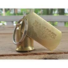 "Load image into Gallery viewer, Brass bell made of a .50 cal shell with brass tag that says ""Tail Gunner Off-Road"""