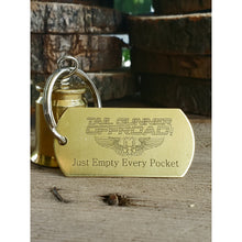 "Load image into Gallery viewer, brass bell made of a .50 cal shell with brass tag that says ""Just Empty Every Pocket"""