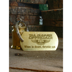 "Brass bell made of a .50 cal shell with brass tag that says ""When in doubt, throttle out"""""