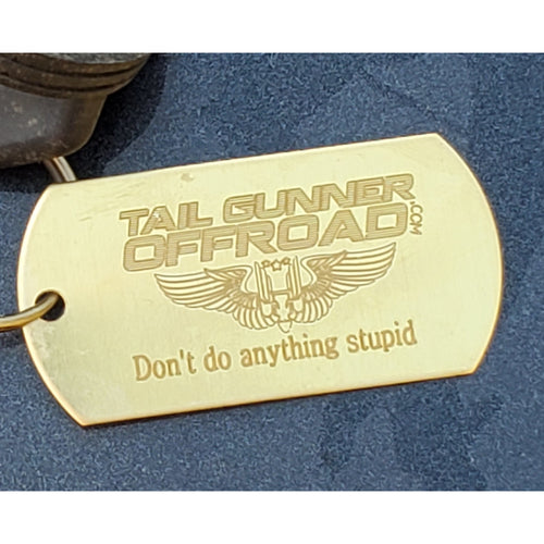 brass dog tag that says