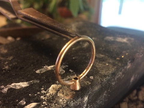 soldering a Beryllina ethical engagement ring of recycled 14K gold