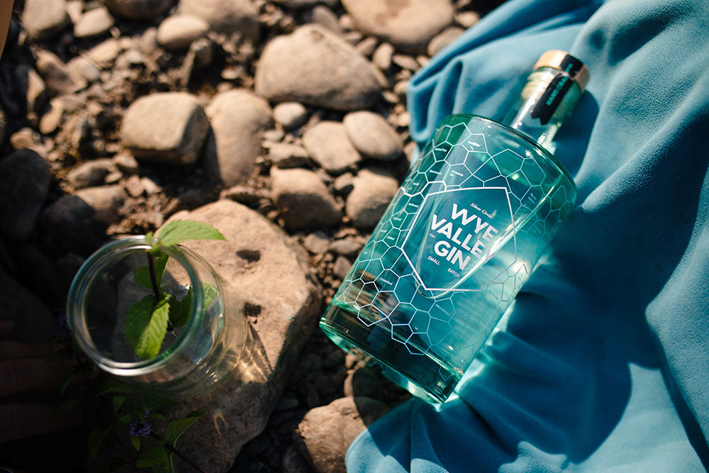 Wye Valley Gin on a stoney beach